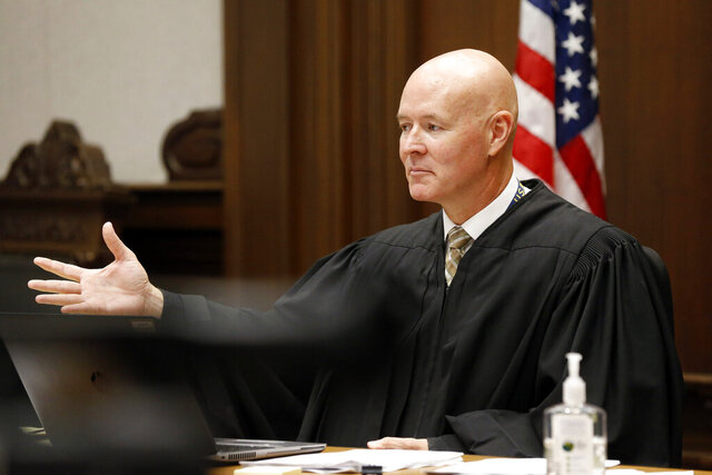 District Court Judge Judge Thornhill presides during a hearing in Linn County District Court in Cedar Rapids, Iowa, on Thursday, Aug. 27, 2020.  Thornhill said Thursday he will rule soon on a request from President Donald Trump's reelection campaign to invalidate 50,000 requests for absentee ballots submitted by voters in Iowa's second-largest county. (Liz Martin/The Gazette via AP, Pool)