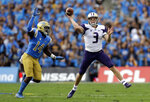 Washington quarterback Jake Browning (3) throws as UCLA linebacker Krys Barnes (14) chases during the first half of an NCAA college football game Saturday, Oct. 6, 2018, in Pasadena, Calif. (AP Photo/Marcio Jose Sanchez)