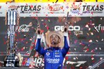 Kyle Larson celebrates in Victory Lane after winning the NASCAR Cup Series All-Star auto race at Texas Motor Speedway in Fort Worth, Texas, Sunday, June 13, 2021. (AP Photo/Tony Gutierrez)