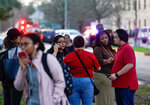 People wait outside Bellaire High School after a shooting, Tuesday, Jan. 14, 2020, in Bellaire, Texas. (Melissa Phillip/Houston Chronicle via AP)