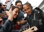 Mercedes driver Lewis Hamilton poses for photos with his fans during an autograph signing opportunity, ahead of the Formula One Grand Prix, in Mexico City, Thursday, Oct. 24, 2019. (AP Photo/Marco Ugarte)