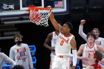 Clemson guard Clyde Trapp (0) dunks against Rutgers during the second half of a men's college basketball game in the first round of the NCAA tournament at Bankers Life Fieldhouse in Indianapolis, Friday, March 19, 2021. (AP Photo/Paul Sancya)