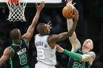 Boston Celtics' Kemba Walker (8) and Daniel Theis (27) defends against Charlotte Hornets' Terry Rozier (3) during the first half of an NBA basketball game in Boston, Sunday, Dec. 22, 2019. (AP Photo/Michael Dwyer)