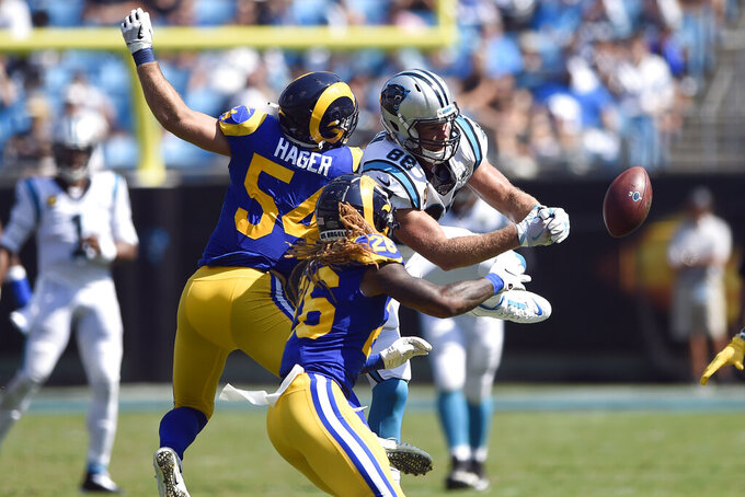 Carolina Panthers tight end Greg Olsen (88) reaches for a pass against Los Angeles Rams linebacker Bryce Hager (54) and defensive back Marqui Christian (26) during the second half of an NFL football game in Charlotte, N.C., Sunday, Sept. 8, 2019. (AP Photo/Mike McCarn)