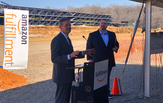 Tennessee Gov. Bill Lee, left, talks about a $200 million Amazon distribution center that is currently under construction on Monday, Jan. 27, 2020, in Memphis, Tenn. At right is Rob Packett, Amazon's director of regional operations. (AP Photo/Adrian Sainz)