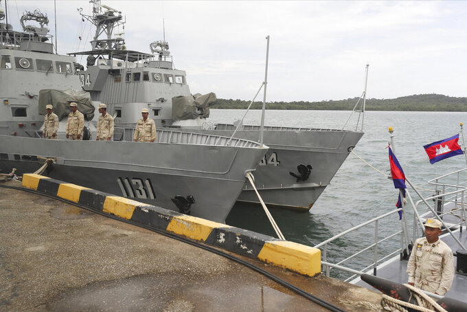 FILE - In this July 26, 2019, file photo, Cambodian navy crew members stand on a navy patrol boat at the Ream Naval Base in Sihanoukville, southwest of Phnom Penh, Cambodia. Efforts by Cambodia to assuage U.S. concerns about China's rights to use a naval base on the Gulf of Thailand suffered a setback Friday, June 11, 2021, when an American diplomat invited to inspect it was allowed only limited access, according to the U.S. Embassy. (AP Photo/Heng Sinith, File)