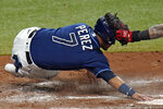 Tampa Bay Rays' Michael Perez beats the tag by Boston Red Sox catcher Christian Vazquez to score on a two-run double by Austin Meadows during the fourth inning of a baseball game Friday, Sept. 11, 2020, in St. Petersburg, Fla. (AP Photo/Chris O'Meara)