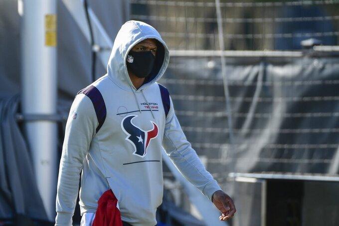 Houston Texans quarterback Deshaun Watson arrives to NFL football practice Wednesday, July 28, 2021, in Houston. (AP Photo/Justin Rex)