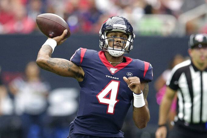 FILE - In this Oct. 6,2019, file photo, Houston Texans quarterback Deshaun Watson (4) throws against the Atlanta Falcons during the first half of an NFL football game in Houston. Houston scored the second-most points (53) in franchise history last week against Atlanta. Watson is possibly the second-most exciting quarterback in the league behind Kansas City Chief's Patrick Mahomes. (AP Photo/Michael Wyke, File)