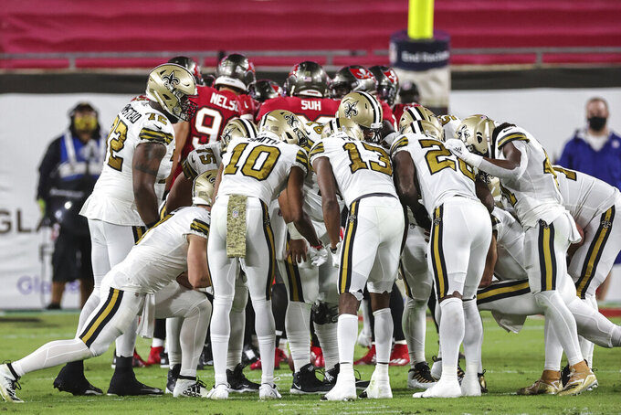 The New Orleans Saints huddle during an NFL game against the Tampa Bay Buccaneers, Sunday, Nov. 8, 2020 in Tampa, Fla. The Saints defeated the Buccaneers 38-3. (Margaret Bowles via AP)