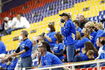 Montezuma fans react to a call in the first half of an 8-man high school football semifinal playoff game between Montezuma and Remsen St. Mary's at the UNI-Dome in Cedar Falls, Iowa, Thursday, Nov. 12, 2020. Capacity for state tournament games has been limited to 2400 and masks are required. (Liz Martin/The Gazette via AP)