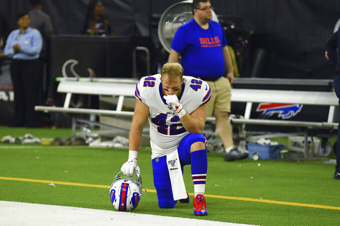Buffalo Bills running back Patrick DiMarco (42) kneels on the sideline after an NFL wild-card playoff football game against the Houston Texans Saturday, Jan. 4, 2020, in Houston. The Texans won 22-19 in overtime.(AP Photo/Eric Christian Smith)