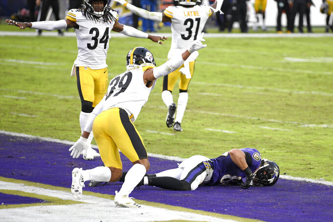 Pittsburgh Steelers free safety Minkah Fitzpatrick (39) reacts after braking up a pass intended for Baltimore Ravens wide receiver Willie Snead, bottom, in the end zone with no time left in the second half of an NFL football game, Sunday, Nov. 1, 2020, in Baltimore. The Steelers won 28-24. (AP Photo/Nick Wass)