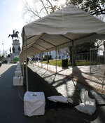 A tent is set up to house metal detectors at the entrance to Capitol Square in Richmond, Va.,  Friday, Jan. 17, 2020. Everyone entering the Square on Monday, Jan. 20 for the pro-gun rally must pass through this point. (Bob Brown/Richmond Times-Dispatch via AP)