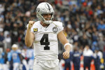 Oakland Raiders quarterback Derek Carr celebrates after a touchdown by running back DeAndre Washington during the second half of an NFL football game against the Los Angeles Chargers Sunday, Dec. 22, 2019, in Carson, Calif. (AP Photo/Marcio Jose Sanchez)