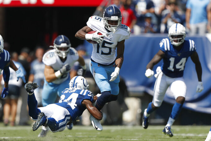 Tennessee Titans wide receiver Darius Jennings (15) is tripped up by Indianapolis Colts cornerback Rock Ya-Sin (34) in the first half of an NFL football game Sunday, Sept. 15, 2019, in Nashville, Tenn. (AP Photo/Wade Payne)
