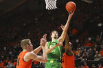 Oregon's Chris Duarte (5) shoots past Oregon State's Kylor Kelley (24) and Alfred Hollins (4) during the first half of an NCAA college basketball game in Corvallis, Ore., Saturday, Feb. 8, 2020. (AP Photo/Amanda Loman)