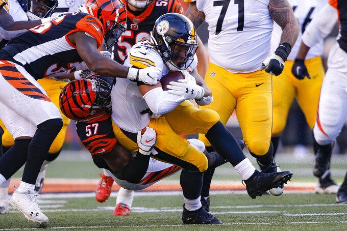 Pittsburgh Steelers running back Benny Snell (24) is tackled on the run by Cincinnati Bengals linebacker Germaine Pratt (57) during the second half an NFL football game, Sunday, Nov. 24, 2019, in Cincinnati. (AP Photo/Gary Landers)