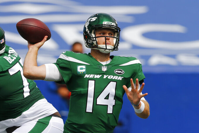 New York Jets quarterback Sam Darnold (14) throws a pass during the first half of an NFL football game against the Buffalo Bills in Orchard Park, N.Y., Sunday, Sept. 13, 2020. (AP Photo/Jeffrey T. Barnes)