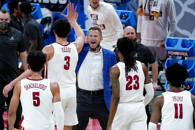 Alabama head coach Nate Oats congratulates players during a timeout in the first half of a college basketball game between Alabama and Maryland in the second round of the NCAA tournament at Bankers Life Fieldhouse in Indianapolis Monday, March 22, 2021. (AP Photo/Mark Humphrey)