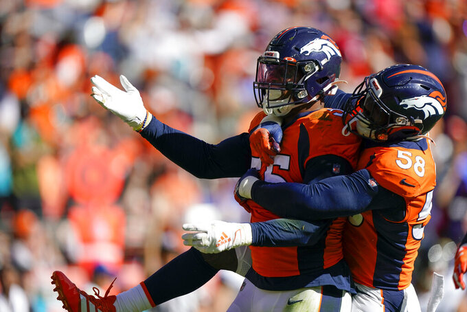 Denver Broncos outside linebacker Bradley Chubb, left, celebrates his sack with teammate outside linebacker Von Miller during the first half of an NFL football game against the Jacksonville Jaguars, Sunday, Sept. 29, 2019, in Denver. (AP Photo/Jack Dempsey)