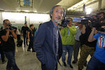 Chinese dissident writer Ma Jian arrives at Hong Kong international airport, Friday, Nov. 9, 2018. Hong Kong on Friday permitted dissident writer Ma to enter to attend a literary festival, even after an arts venue in the city canceled his appearance. Ma, whose novels frequently satirize China's communist leaders, told reporters he experienced nothing unusual while passing through passport control and that organizers were still lining-up a place for him to speak.