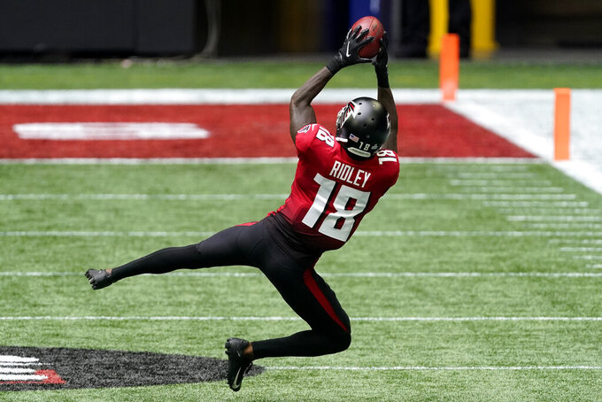 Atlanta Falcons wide receiver Calvin Ridley (18) makes the catch against the Detroit Lions during the first half of an NFL football game, Sunday, Oct. 25, 2020, in Atlanta. (AP Photo/John Bazemore)