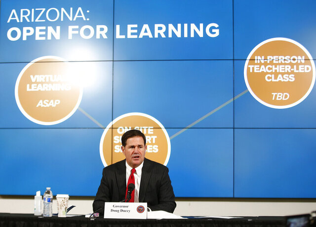 Gov. Doug Ducey talks about schools in Arizona and reopening for the fall semester during press conference on COVID-19 in the state at the Arizona Commerce Authority Conference Center in Phoenix on Thursday, July 30, 2020. (Patrick Breen/The Arizona Republic via AP, Pool)