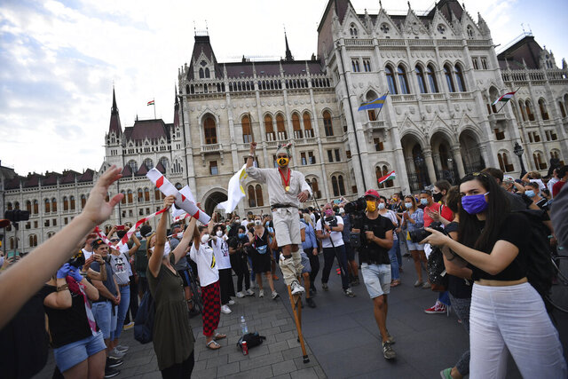 Students of the University of Theatre and Film Arts (SZFE) and their sympathizers form a human chain in protest against changes to the way the university is governed in Budapest, Hungary, Sunday, Sept. 6, 2020.  (Marton Monus/MTI via AP)