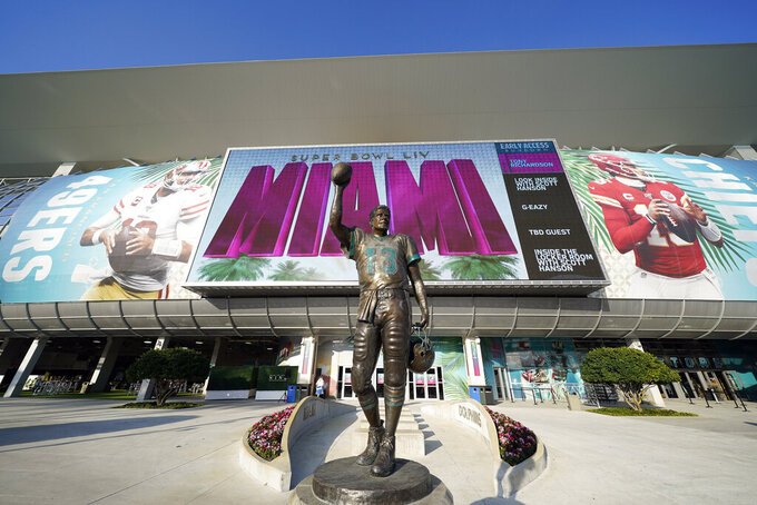 A statue of NFL Hall of Fame quarterback Dan Marino stands outside Hard Rock Stadium Thursday, Jan. 30, 2020, in Miami Gardens, Fla., in preparation for the NFL Super Bowl 54 football game. (AP Photo/David J. Phillip)