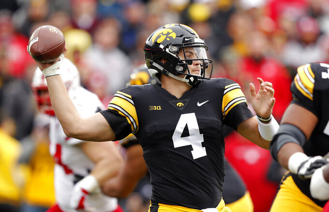 Iowa quarterback Nate Stanley throws a pass during the first half of an NCAA college football game against Nebraska, Friday, Nov. 23, 2018, in Iowa City, Iowa. (AP Photo/Charlie Neibergall)
