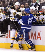 Toronto Maple Leafs left wing Andreas Johnsson (18) gets physical with Boston Bruins defenceman Zdeno Chara (33) during first period NHL hockey action in Toronto, Saturday, Oct. 19, 2019. (Fred Thornhill/The Canadian Press via AP)