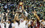 FILE - South Carolina forward A'ja Wilson (22) holds the trophy as she and her teammates celebrate a win over Mississippi State in the final of NCAA women's Final Four college basketball tournament in Dallas, in this Sunday, April 2, 2017, file photo. South Carolina won 67-55. Wilson, preparing for her fourth season with the Las Vegas Aces of the WNBA as the league's reigning MVP was the guest of honor at Monday's Jan. 18, 2021, official christening of a statue of her likeness that honors her play off the court and representation of the university and athletics program away from competition.(AP Photo/Tony Gutierrez, File)