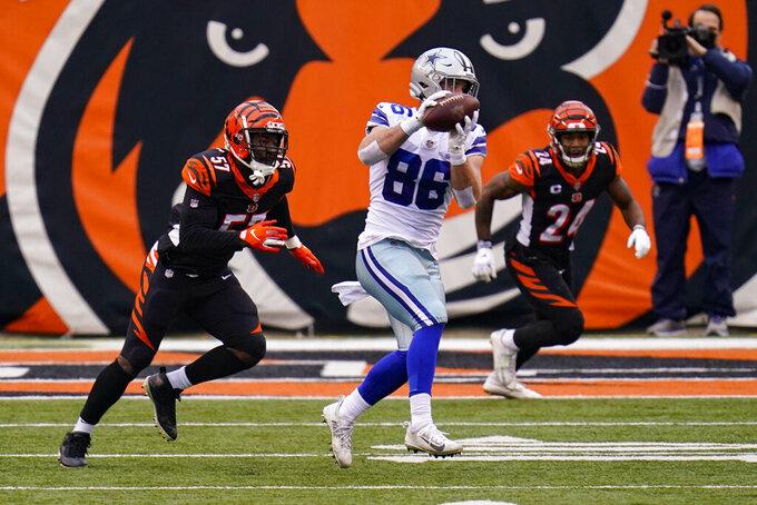 Dallas Cowboys wide receiver CeeDee Lamb (88) makes a catch in front of Cincinnati Bengals linebacker Germaine Pratt (57) in the first half of an NFL football game in Cincinnati, Sunday, Dec. 13, 2020. (AP Photo/Bryan Woolston)