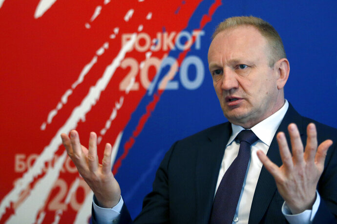 """In this photo taken on Wednesday, June 17, 2020, Opposition Leader Dragan Djilas gestures during an interview with the Associated Press, in Belgrade, Serbia, Wednesday, June 17, 2020. A Serbian opposition leader whose group is boycotting the country's parliamentary election on Sunday says taking part in the vote amid the coronaviorus pandemic and without free media would only legitimize what he called a """"hoax vote.""""  (AP Photo/Darko Vojinovic)"""