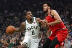 Milwaukee Bucks' Eric Bledsoe tries to drive past Portland Trail Blazers' Skal Labissiere during the first half of an NBA basketball game Thursday, Nov. 21, 2019, in Milwaukee. (AP Photo/Morry Gash)