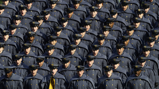 Army cadets cheer after marching onto the field before an NCAA college football game against Navy, Saturday, Dec. 8, 2018, in Philadelphia. (AP Photo/Matt Slocum)