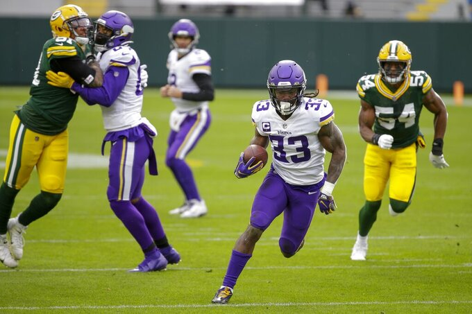 Minnesota Vikings' Dalvin Cook runs for a touchdown during the first half of an NFL football game against the Green Bay Packers Sunday, Nov. 1, 2020, in Green Bay, Wis. (AP Photo/Mike Roemer)