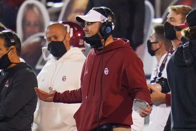 """FILE - In this Nov. 21, 2020, file photo, Oklahoma coach Lincoln Riley gestures during the second half of the team's NCAA college football game against Oklahoma State in Norman, Okla. Oklahoma is in its 12th Big 12 championship game, all four since the title game returned after a six-season hiatus. """"The game is going to be what it should be,"""" Sooners coach Riley said. """"It's going to be two really good football teams that have had really good years going at it."""" (AP Photo/Sue Ogrocki, File)"""