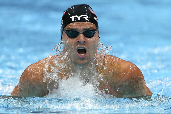 Michael Andrew of the United States swims in a men's 200-meter individual medley semifinal at the 2020 Summer Olympics, Thursday, July 29, 2021, in Tokyo, Japan. (AP Photo/Matthias Schrader)