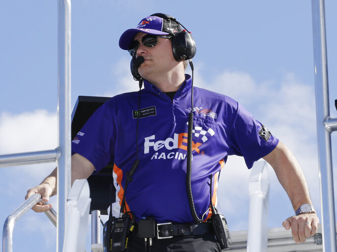 Crew Chief Christopher Gabehart watches practice for a NASCAR Cup Series auto race on Saturday, Nov. 16, 2019, at Homestead-Miami Speedway in Homestead, Fla. Gabehart is the crew chief for Denny Hamlin (11). (AP Photo/Terry Renna)