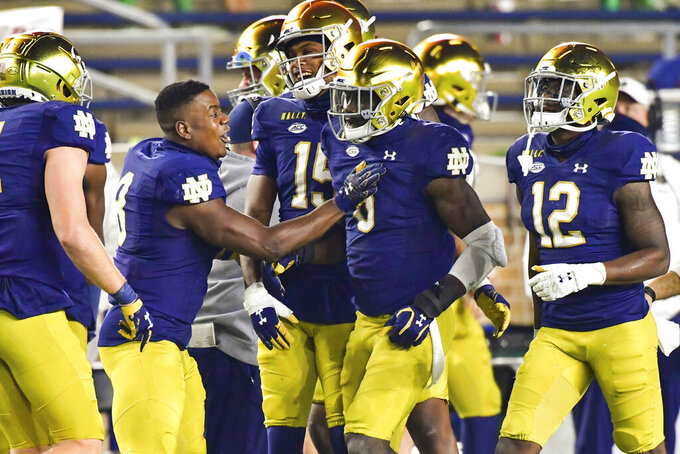 Notre Dame linebacker Jeremiah Owusu-Koramoah (6) celebrates after a touchdown against Clemson during the second quarter of an NCAA college football game Saturday, Nov. 7, 2020, in South Bend, Ind. (Matt Cashore/Pool Photo via AP)