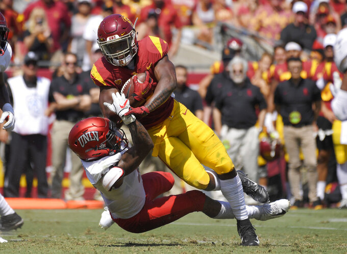 Southern California running back Stephen Carr, top, is tackled by UNLV defensive back Jericho Flowers during the first half of an NCAA college football game Saturday, Sept. 1, 2018, in Los Angeles. (AP Photo/Mark J. Terrill)