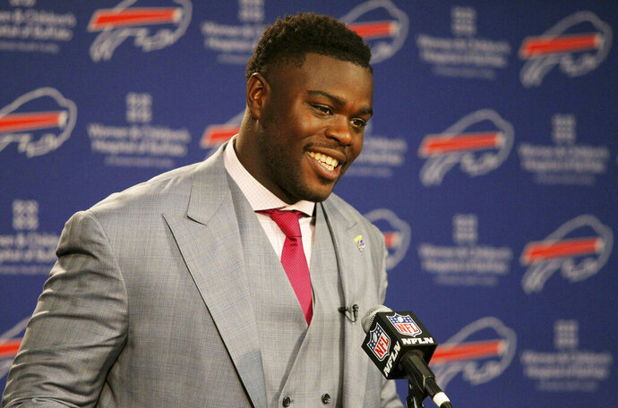 FILE - In this April 29, 2016 file photo, Buffalo Bills first round NFL football draft pick Shaq Lawson speaks at a media conference at the team facilities in Orchard Park, N.Y.  Lawson says he will pay for the funeral of an 11-year-old South Carolina girl who died after someone fired more than 35 shots at her home. News outlets report a family member announced Lawson's contribution Wednesday evening, June 26, 2019, at a vigil for Ja'Naiya Scott. Someone fired shots at the house in Anderson on Sunday morning, June 23. Ja'Naiya's 18-year-old sister and her 11-year-old cousin were also wounded.   (AP Photo/Bill Wippert, File)