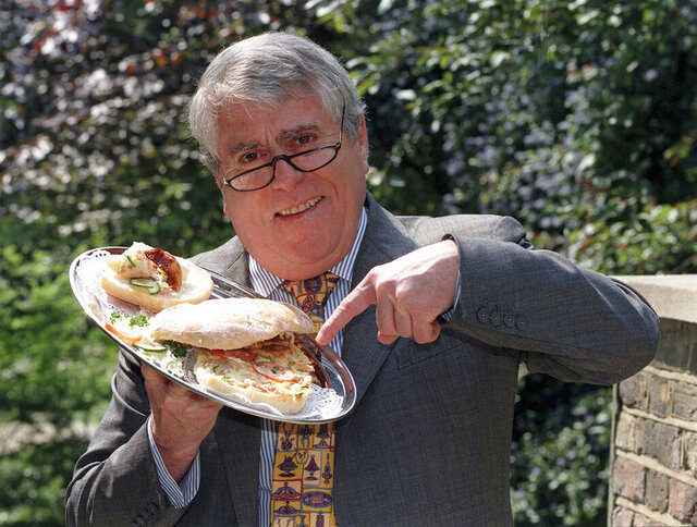 FILE - In this May 16, 1997 file photo, Albert Roux poses for a photo. Roux, the French-born chef and restaurateur who along with his late brother Michel had a profound influence on British dining habits, has died. He was 85, it was reported on Wednesday, Jan. 6, 2021. The brothers are widely credited with revolutionizing Britain's staid and old-fashioned culinary scene, notably with their opening of Le Gavroche in London in 1967, a restaurant that was frequented by a loyal clientele that included many of the icons of the Swinging Sixties in London. (PA via AP, File)