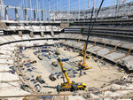 Construction workers continue work in the bowl of the NFL stadium rising in Inglewood, Calif., Tuesday, July 30, 2019. The multi-billion-dollar complex is on schedule to open in July 2020. Officials from the NFL, the Los Angeles Rams and the Los Angeles Chargers toured the stadium as part of early preparations for the Super Bowl in February 2022. (AP Photo/Greg Beacham)