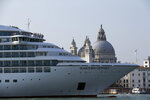 """FILE--  In this Sept. 27, 2014 file photo a cruise ship transits in the Giudecca canal in front of St. Mark's Square, in Venice, Italy. Declaring Venice's waterways a """"national monument,"""" Italy is banning mammoth cruise liners from sailing into the lagoon city, which risked within days being declared an imperiled world heritage site by the United Nations. Culture Minister Dario Franceschini said the ban will take effect on Aug. 1 and was urgently adopted at a Cabinet meeting on Tuesday. (AP Photo/Andrew Medichini)"""