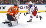 New York Rangers' Greg McKegg (14) is stopped by Edmonton Oilers goalie Mikko Koskinen (19) during third period NHL hockey action in Edmonton, Alberta, Tuesday, Dec. 31, 2019. (Jason Franson/The Canadian Press via AP)