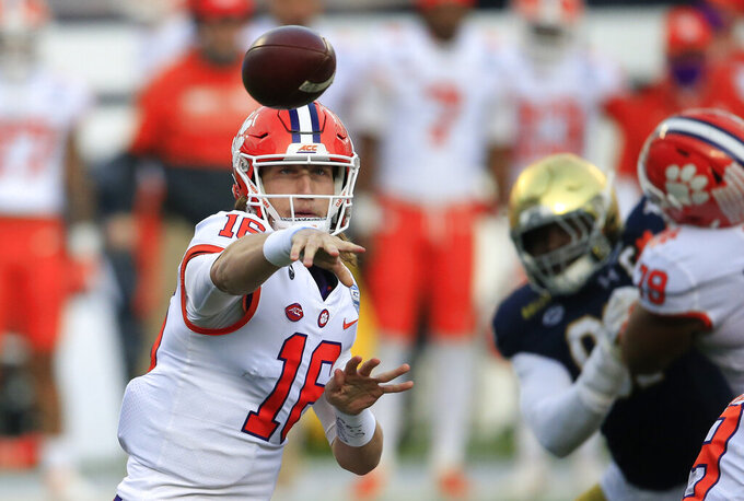 FILE - In this Saturday, Dec. 19, 2020, file photo, Clemson quarterback Trevor Lawrence (16) throws to an open receiver during the first half of the Atlantic Coast Conference championship NCAA college football game against Notre Dame in Charlotte, N.C. Lawrence has been named a finalist for the Heisman Trophy. The Heisman will be awarded Jan. 5 during a virtual ceremony as the pandemic forced the cancellation of the usual trip to New York that for the presentation that usually comes with being a finalist.  (AP Photo/Brian Blanco, File)