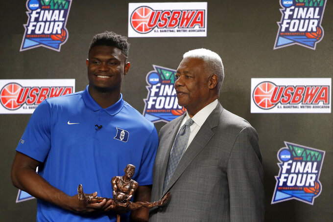 Duke freshman Zion Williamson and National Collegiate Basketball Hall of Fame member Oscar Robertson pose with the Oscar Robertson Trophy at a news conference where Williamson was awarded the U.S. Basketball Writers Association College Player of the Year award at the Final Four NCAA college basketball tournament, Friday, April 5, 2019, in Minneapolis. (AP Photo/Charlie Neibergall)